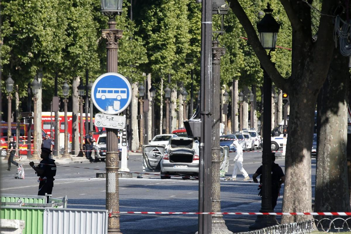 Car rams police van on Paris' Champs Elysees