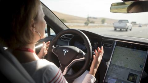 The Autopilot features are demonstrated in a Tesla Model S during a company event in Palo Alto, Calif. in October 2015.