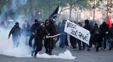 Police use smoke pellets, moving toward protesters in center of Paris