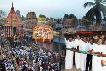 Brihadeeswarar Temple car was pulled by devotees and VIPs along the four streets around the temple
