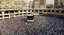 Muslim pilgrims circle the Kaaba at the Grand mosque in Mecca, Saudi Arabia