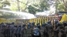 police used water canons to disperse protesting students